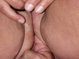 Two fingers deep in her ass