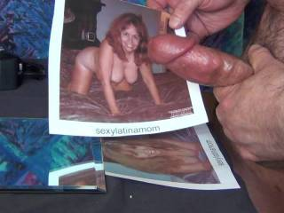One heck of a sexy woman. SexyLatinaMom. My cum shot was huge over her....