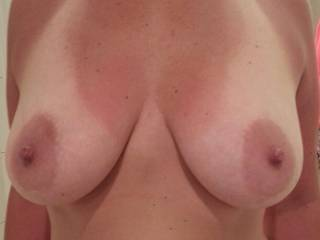 Beautiful tits! I love your big nipples! I wanna suck em for a few hours,may I?