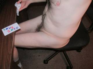 A side sitting profile view,while cleaning my desk...With a view of my pubic hair...