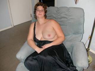 Mann and you look so sexy in black satin. After I suck on your lovely breasts I'd hike up your long gown and spread your legs so I can eat your pussy and when you're ready I turn you around and slide my cock into your pussy and fuck you from behind. As I squeeze your ass and reach around to rub your clit and tease your nipples.