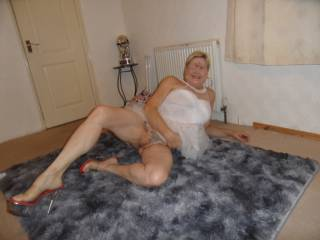 hi all just relaxing on the rug flashing my smooth pussy eagerly awaiting suggestions dirty comments welcome mature couple