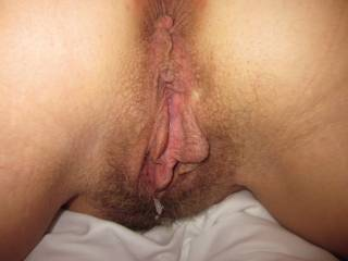 That is one gorgeous very hairy pussy soooooooooooo sexy filled with creamy cum, has me wanting to slide my meaty mature cock inside for wild sloppy seconds and pump you another good load of thick sticky cummm!