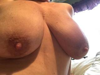 I would enjoy sucking on your big natural tits, nibbling on your pink nipples, sliding my hard black cock between them, fucking them, and cumming all over them.