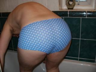 bent over in snug panties