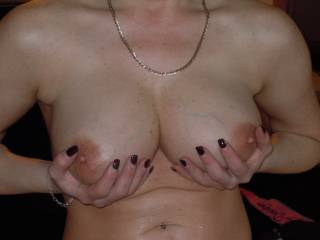 Absolutely amazing tits.  I'd help hold them, lick them, caress them, whatever you like.