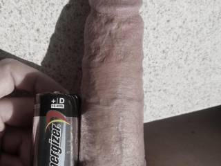 At 6.5 inches long when fully flaccid, I still dwarf a D battery. This shot was for a future lover who wanted me to compare mine to her cuck boyfriend\'s tiny stub...he isn\'t even as long as the battery (2.25 long).