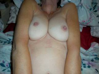 Would you like to cum over my tits? My husband would love to watch someone cum all over my tits.