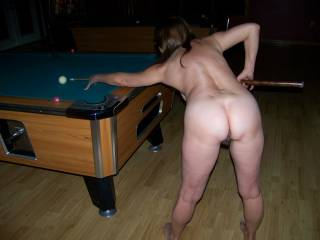 Shooting a game of pool naked at our local pub. I\'m a real exhibitionist.