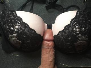 saw her bra laying there couldn\'t resist just sliding the tip between them