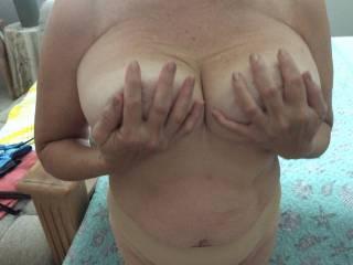 Holding boobs