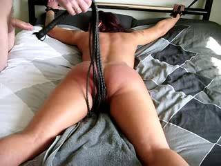 little demo of kinkyslut tied to the bed & whipped into a juicy mess