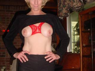 Cute face, great body, and beautiful tits too.  That's one smokin' hot MILF you have there...
