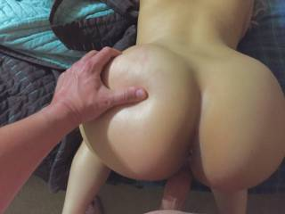 Pounding her sweet little Pusey from the back. Her bubble butt is a perfect handle.