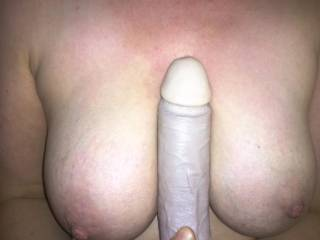 After using my big black dildo i like to rest it between my breasts while my husband fucks me stupid. I\'m practicing till i get the real thing.
