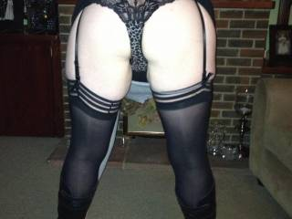 Looking very sexy with this lingerie! If she's asking for a good spanking, why not, with such great ass you can't resist!