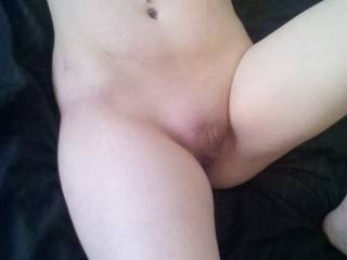That is such a pretty little pussy I would love to bury my face there and then slide my cock balls deep in it