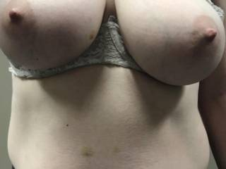 Kiki leaving her big tits out while finishing a beer and getting dressed after getting fucked well and filled with cum on the couch in my office.