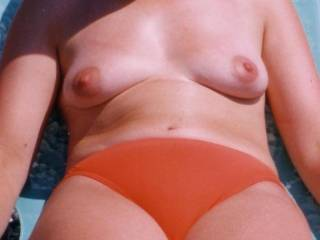 sunbathing topless to catch the lads eyes