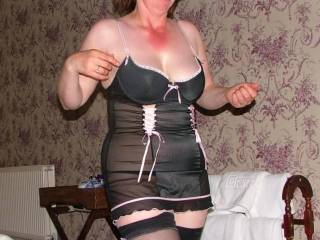 We think........ Wow!!!!! Would love to share this lady with you. Very very sexy outfit and a superb smile and great boobs. top marks xxx