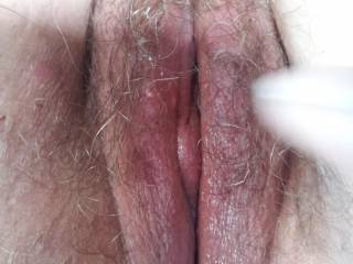 I'd love to play with your lovely hairy pussy. Looks nice and wet, yummmm.