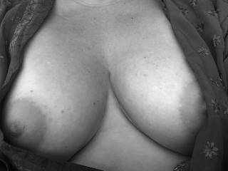 B&W tits.. Anyone for a titty-fuck? Cum tributes wanted! Would love some cock between my titties and rub cream on my hard nipples... mmm, suck a nice cock head as it slides up between my boobs