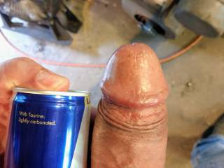 A new quick photo of my thick cock . Was horny and thought id compare myself to a redbull can.. lol