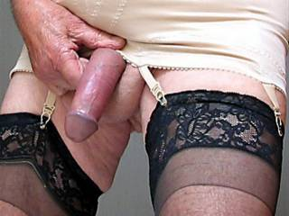 nice photo, would love to see more of you in those sheer stockings working that cock over!  maybe a video too!!
