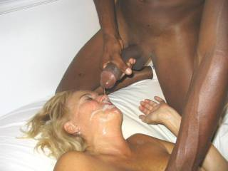 Hot, mature woman being fed BBC cum. I bet he wore out your pussy before he fed you.