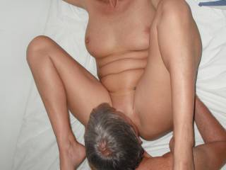 Our swinger friend eats out my pussy, when he came around for a threesome.