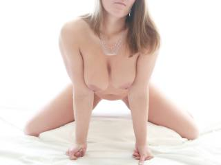 looks like I should have signed on yesterday. What an erotic photo of those beautiful big tits, her sexy thighs, luscious lips. I want to walk up to her, my cock bouncing with each step, run my hands through her hair, look down into her eyes as she softly licks from my balls to my tip, my hands giving just a slight tug on her hair, mixing that sensuality of the moment with a hint of the aggressiveness to come