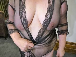 My wife's beautiful tits under see through black  nylon.