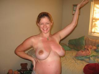 oh so hot and sexy....lovely titties and tummy! very nice smile too!