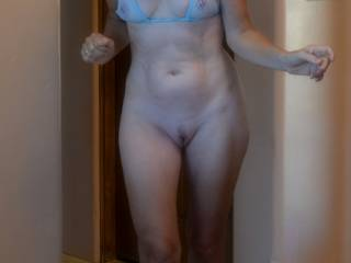 The wife came out of the bathroom bottomless.  I had to take pictures of her.  She looks damn sexy bottomless.  Do you like her MS swimsuit I bought her.