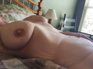 like those dark brown areola round your nipples I'd love to suck, on those nice tits. Nice flat tummy, would love to make you cum a lot if I were not near Stratford-on-Avon in England