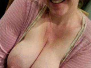 Squeezing her big lactating breasts together at the kitchen table right after pumping them... wish I had grabbed the camera before she started... they were even bigger!