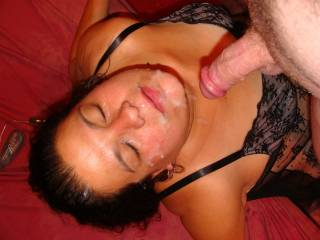 big blast of cum all over her face