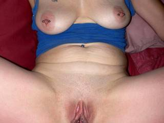 Your pussy is amazing! Perfectly shaved, lips ready for action, and legs spread wide. And the tits falling out of yor top. Yop photo...its all so good!!!
