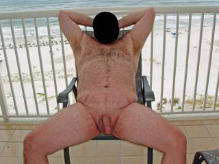Hubby posing in the nude at our condo while on our summer 2008 beach vacation.  The condo housekeeping lady had walked in during the previous pic...she left our clean towels, but hung around long enough to chat (and stare at hubby\'s cock) and watch this p
