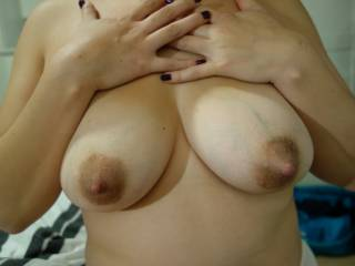 OMG - another awesome shot.  With those dark areola & huge nipples & the way you are pressing on you tits - makes me imagine huge jets of milk squirting from you nipples just a second after this pic was taken.  Suckle me, feed me & take me to bed for playtime!