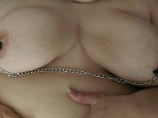 I like them...have her lift that chain and stretch those big nipples