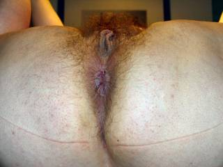 Wife showing thick meaty cunt lips and veteran anus.