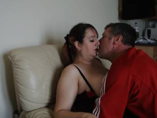 Me making out with a guy we met online as my hubby watched
