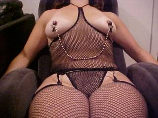 No, I Love It!!  She is so Sultry Hottt and Seductive in her slutty fishnets and hottt nipple clips!!  I so want to pull her chain lick suck and nibble her awesome hard nipples and tear open those hot fishnet panties throw her legs over my shoulders and bury my thick throbbing cock balls deep inside her pulsating wet pussy, while I keep sucking and pulling on those clips, driving her crazy!!