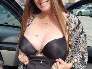 Showing off my push up bra in the mall parking lot