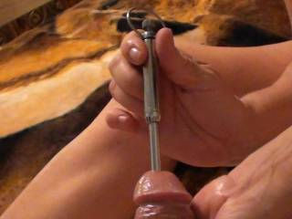 Girlfriend stroking my cock on the outside with her hand and on the inside with the vibrating sound by pushing it in and pulling it out. She is literally fucking my cock with the rod. And it feels sooooo good.  Would you like this done to you?
