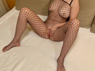 Spreading pussy in fishnet