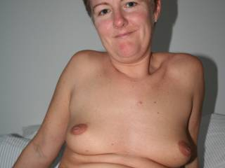 love your sweet tits and nips, could suck and play with you for hours, and you have a cute face too.