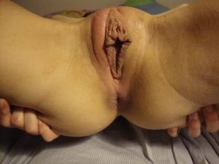 That is my definition of 'perfect pussy'.  What stunning set of big, fleshy lips you have - I would love to feel them sliding and wrapped around my cock....or maybe have you splay them over my nose as I dip my tongue into your hole.
