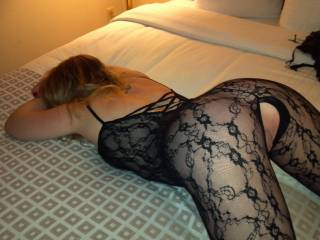 She looks soooo hot with her ass up and wearing that lacy outfit -- so fuckable